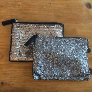 LOFT glittery/shimmering zip-up pouches